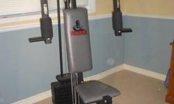 Total home gym Asking $55 Great working condition Includes: attachments (bar and tricep rope)
