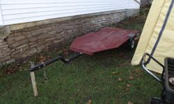 Home Make  4x8 trailer  with 3/4 inch plywood top , 1 7/8 reciever tows easy. could be converted into a box utility/ build A frame to transport three canoes /motorcycle trailer/ small sailboat / snowblower/ lawnmower asking $200 or best reasonable offer