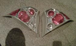 I have a pair of Anzo Tail Lights - Halo for a Honda Civic 01 and up 2-DR models. They are in mint condition. Anzo USA part# 03-HC2001TLA2DG4 (if you'd like to research them)