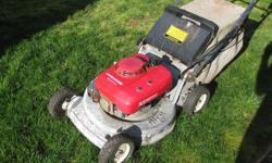 Heavy commercial model self propelled mower. We inherited this mower from an estate and it is too big for our small yard.
