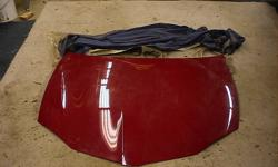 03-05 OEM Pontiac sunfire hood.  Was only on car for two years and has been stored indoors since.  Hood only, no mounting hardware.