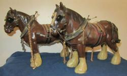 Two beautiful matching  ceramic horses complete  with harness Stand 10.5 inches tall x  14 inches nose to tail