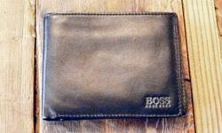 Hugo Boss Wallet Black leather. Never used, in perfect shape. Email, call or text: 403-651-2385