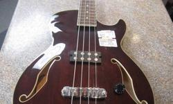 Ibanez Artcore AGB140-TBR Semi-Hollow Bass Guitar. Includes Ibanez hard case. Very good condition. See our other ads. Swap Shop 416-701-1701 Due to the volume of emails we receive we ask that you please CALL US INSTEAD, that way we can provide you with
