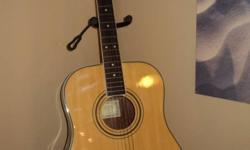 Great guitar in new condition with carrying case. model is aw200
