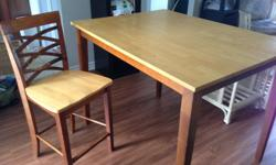 Dining set in used condition (some scratches on wood, which can be re-varnished). High chairs to match high table height.