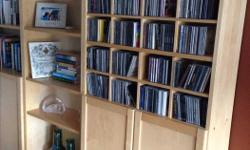 """IKEA Billy bookcase - Last unit on Right Measurement: End unit 31.5""""W, 11""""D, 79""""H CD Holder can be removed (just slots into bookcase and sits on the shelves). Doors can also be removed. TWO UNITS SOLD, ONLY ONE REMAINING ON RIGHT"""