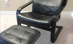 Black frame with black leather cushion and footstool in excellent condition. Delivery available for a small fee, depending on your location in the city.