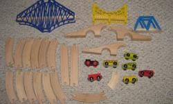 Hello, we are selling a small lot of Ikea wooden train track and some trains. The set includes three bridges; the smaller blue one fits nicely with the tracks, but the big blue one and the yellow one are at awkward heights to fit with the track. You'll