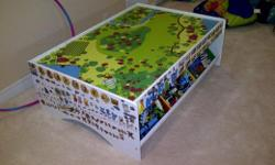 Imagination Train table with 6 storage bins. Asking $40. Pick up in Barrhaven