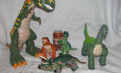 Hello, we are selling a lot of Imaginext Dinosaurs. There are several dinosaurs: a tall T-Rex, a brontosaurs, a triceratops, two smaller dinos, and two cave men. The T-Rex takes batteries, and when you hold a button on his back waves his arms, moves his