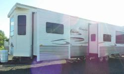 This beautiful cottage on wheels can comfortably sleep 7 and boasts 3 power slide outs, 18' power awning, 2 bedrooms, 2 bathrooms, 4 person dinette with storage in the table and chairs. With many upper and lower cabinets and 3 closets, you will not be