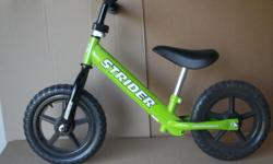 BEST KIDS BALANCE BIKE. IN MINT CONDITION , STRIDER BALANCE BIKE GREEN SKILL-BUILDING,ENTRY-LEVEL MODEL. NO PEDALS TODDLERS TRAINING LIGHT WEIGHT. FOR AGE 18 MONTHS TO 3 YEARS OLD;SEAT RANGE OF 28-41 CM ( 11-16 IN ) WITH ADJUSTABLE HANDLE AND SEAT.