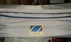 These are underseat storage bags for use on a Zodiac inflatable boat. The storage area measures 27X8X7. It wraps around....top is cushioned for sitting as shown in second picture. I have 4 of these for sale. NEW! Thanks for looking.