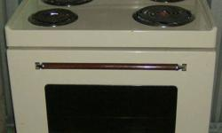 almond colour Inglis stove,clean $50 obo