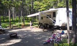 Priced to sell!!  Trailer is SUV towable, only weighs 3900 lbs empty.  Unit is well equipped with Jack & Jill bunks, microwave, air conditioning.  Large holding tanks - 51 gallon fresh water, 37 gallon grey and black holding tanks. Call for more