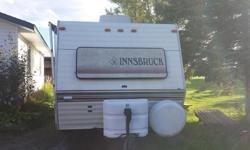 1998 Innsbruck 24ft Travel Trailer. Rear double bed and front dinette. Washroom and storage closet in center of unit. New tires 2 years ago with approximately 200 hundred kilometers on them. Comes with 2 door 6 foot cubic refrigerator and working 13000