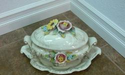 This set is from Italy and consists of soup serving bowl and tray. Authentic Capadomonte and a lovely decorator piece or dining room serving set. I also have an Italian tapestry in warm tomes that fits in any color scheme. It comes with a hanging rod for