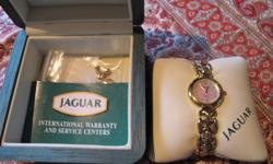 Women's 18K Gold plated Jaguar Watch... still in box and never been worn! It also comes with original papersand 2 spare chains to make the watch bigger. Asking $85 obo