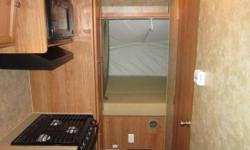 Purchased new in 2009, New Awning and kitchen faucets in 2010 replaced under warranty.  Sleeps 6, has AC, ducted heat, two way refrigerator, microwave, 3 burner stove and shower.  The best part is being a hybrid you can tow with your Minivan.  We have a