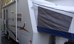 2005 Hybrid trailer. Queen and Double bunk ends. Dinette makes into a bed  Three piece bathroom, outside shower.  3 way automatic fridge with freezer, air conditioning, CD stereo player and microwave, 3 burner stove with oven. Two propane tanks and