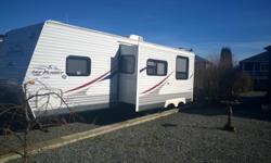 2011, 28 foot Jayco Travel Trailer for sale 1 large slide & Power Awning Rear bathroom, shower Microwave, TV, Fridge, Air Conditioning Immaculate inside and used one summer