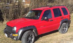 Make Jeep Colour Red Trans Automatic 2003 red Jeep Liberty, 3.7lt V6, automatic, 4x4 176,000 K New Michelin winter tires plus spare Leather/fabric sports seats electric Windows/mirrors CD player Privacy glass
