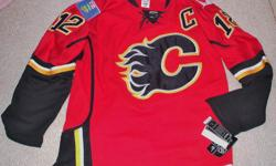 For Sale: Calgary Flames `Iginla` jersey by Reebok/CCM. Embroidered cresting & Logos. #12 Iginla-on back. Provincial & Canada flag crests. Laceup Neck Tie down strap-Size Large or 52. Mint condition..Still has Tags...$75.