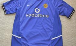 For Sale; Man.U. jersey by Nike. Blank on back of jersey Made in U.K.- Vodafone - Dark Blue Sized XL....$15.