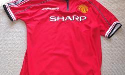 For Sale; Man.U jersey by Umbro. Zippered neck - Blank on back of jersey VapaTechl - Sized XL Sized XL....$15.