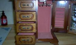 """Great Christmas Gift !!!!! THis barely used substantial crafted box would be an excellent gift on Christmas morning. Great for hiding """"rings"""" in. No chips or scrapes and even plays a tune.  It measures 10"""" high, 9"""" wide, and 5"""" deep.  Sits nicely on a"""