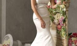 I am selling a stunning, timless jim hjelm bridal gown.  The gown is Ivory,  silk duchess satin.  fantastic fabric (you really can feel the difference). Trumpet style, strapless empire waist.  The bodice is accented with crystal beaded trim and a chapel