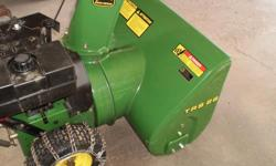 """8 H.P. Tecumseh Engine 26"""" Cut. Model TRS26. Electric Start, Oil Changed. Tire Chains. Works Very Well . Call 306-949-1251."""