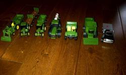 John Deere 2 small tractors 1 Small loader 1 medium tractor 1 combine 1 Gator 1 Flat bed truck 5 assorted trailers
