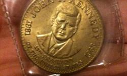 this is an amazing condition coin its in a plastic case it is a 35th president remembrance coin the year is 1981 any other questions let me know :) feel free to text me at 289 688 9595