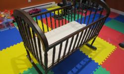 Selling Jolly Jumper wooden cradle with matress and matching bedding set. Everything is clean from non-smoking no-pets home, practically new. First come first served. E-mail or text for more info.