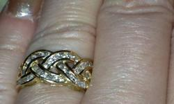 I am offering for sale one Ladies 14K gold with 1 carat of bright and sparkling diamonds in braided look diamond ring.   A truly unique design that I've not seen in any jewellery stores, with diamonds of a far better quality than found in traditional
