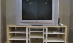 32 inch 4:3 screen ratio. Good picture (keeping in mind the technology), great sound from built in speakers. TV bench in pictures comes with it. {Please note, the TV is heavy - if you want it, plan to bring a strong friend or 2). Great basement or kids TV