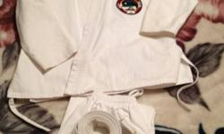 White Gi in size 1/140 Inseam is 22 inches and has NOT been altered in any way. Patch is easily removed and replaced with your club's logo.