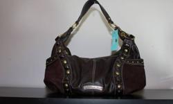 """Kathy Van Zeeland Brand new with tags, brown """"Idol hobo"""" purse.  Retails for $110.00.  Gold interior, with many interior compartments.  Zippered pocket on the back of the purse.  Super cute detailing on the front of the purse.  Can match any outfit."""
