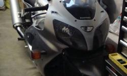 2006 KAWASAKI  ZZR 600 NEVER USED,STORED IN GARAGE,MINT CONDITION NO SCRATCHES,NEVER DROPPED,INCLUDES HELMET AND XL ICON JACKET,MY WIFE SAYS IT HAS TO GO. HAVE ALL SERVICE RECORDS,SAYS I AM TO OLD FART TO HAVE ONE.   '' NO PAYPAL''