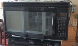 """Black Kenmore Over the Range microwave, Model 85439, 1050 Watts, 1.9 cu.ft Capacity. Has stove exhaust with metal filters and halogen lights. Dimensions: 29 7/8"""" W X 16 1/2"""" H X 15 1/4"""" D. Excellent Condition"""
