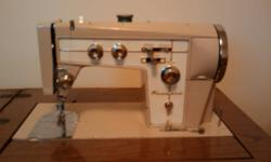 I have a Kenmore Tri Span 88 Automatic in very good condition in the original cabinet that comes with 30 embroidery cams, extra feet and bobbins in the accessory kit. The machine is very clean and the motor has new brushes and also has a new drive belt