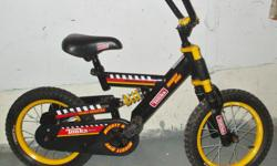 """For Sale: Wee kids `Tonka` BMX style bike. 14"""" wheels-1speed-foot braking..Front shock! Adjustable quick release seat post. 11"""" frame. Great condition-Safe Solid...$30."""