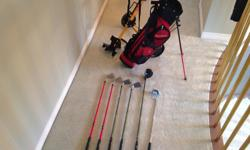 This is a very good set of KIDS GOLF CLUBS... INCLUDES: BAg with stand... Kids golf cart.. Wilson Putter... Driver.. 7,8,9,pw Tees... Golf balls... Everything you need to get stated