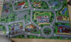 I have a gentley used kids large size road map rug for sale!! Bought it for my son and he barley used it.... Is great for kids and keeps them busy playing for hours!!   Has been kept in great condition!   Asking $20.00 FIRM Niagara Falls Area Please See