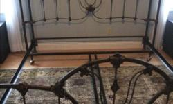 Beautiful antique-finish head and foot board and king size frame. Box spring included (comes in two pieces)