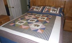Brand new quilt as shown. Reverses to solid blue. 100% cotton. Just not our style. Please call 705-787-0543