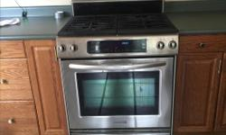 Stainless steel gas stove and oven with bottom warmer! Ready to go ! Approximately 10 years old in very good shape