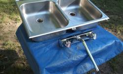 1= double kitchen sink, good condition, asking 35.00 1 = set of taps, good condition, asking 5.00 email or call 705-789-9351